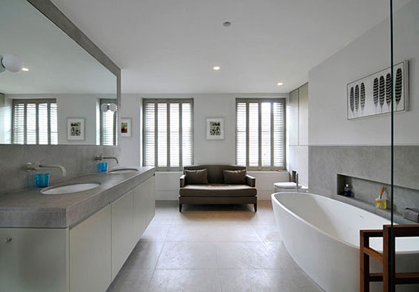 Comfy, roomy master bath.  Natural light, comfy sofa and requisite double sink. Add color with towels and rugs. Close to perfect.