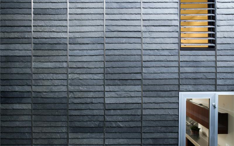 Elongated slate tile siding at rear