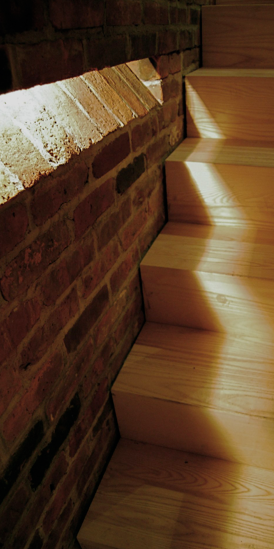 Brooklyn Townhouse Step Detail. Lighting inset into brick wall.