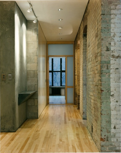 There's something about raw masonry walls and wood floors that is perfect.